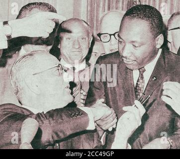 President Lyndon Johnson shakes hands with Reverend Martin Luther King, Jr., on July 3, 1964 in Washington, District of Columbia, after handing him a - Stock Photo