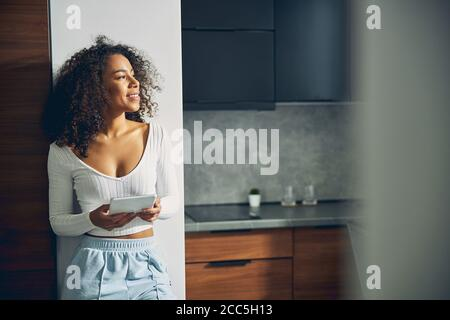 Beautiful brunette woman staying alone and relaxing - Stock Photo