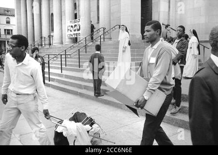 African American Men carrying Supplies from Food Distribution Center at Church after Riots following Dr. Martin Luther King Jr's, Assassination, 7th and N Street, N.W., Washington, D.C., USA, Warren K. Leffler, April 8, 1968 - Stock Photo