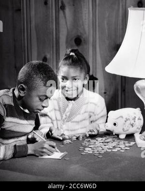 1960s FRUGAL SMILING AFRICAN-AMERICAN BOY GIRL BROTHER SISTER COUNTING MONEY FROM THEIR PIGGY BANK - bj00303 CAM001 HARS JOY LIFESTYLE SATISFACTION FEMALES BROTHERS HOME LIFE FINANCES COPY SPACE FRIENDSHIP HALF-LENGTH MALES SIBLINGS CONFIDENCE SHARE SISTERS B&W GOALS DREAMS HAPPINESS AFRICAN-AMERICANS AFRICAN-AMERICAN CAM001 BLACK ETHNICITY PRIDE SIBLING CONNECTION COOPERATION JUVENILES PRE-TEEN PRE-TEEN BOY PRE-TEEN GIRL TOGETHERNESS BLACK AND WHITE OLD FASHIONED AFRICAN AMERICANS - Stock Photo