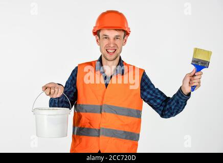 tools for repair. young man in hard hat. man builder use paiting brush. professional repairman in helmet. build and construction. skilled architect repair and fix. engineer worker career. - Stock Photo