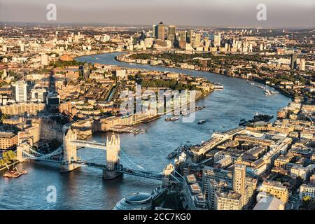 London city skyline aerial view at sunset with The Shard tower shadow, UK, Great Britain. Famous Europe travel destination. Tower bridge and Thames
