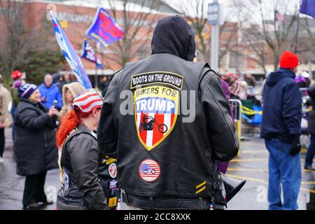 Supporters of 45th United States American President Donald J. Trump Rallied the crowd of people outside waiting to get into the Panther Arena. Stock Photo