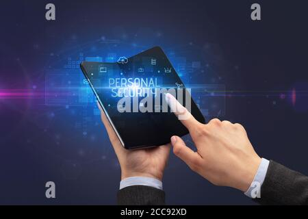 Businessman holding a foldable smartphone with PERSONAL SECURITY inscription, cyber security concept