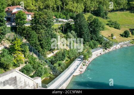 Bern Switzerland , 27 June 2020 : Top view of Bern Bear pit park or Barengraben and people on Aare river banks during summer 2020 in Bern Switzerland - Stock Photo