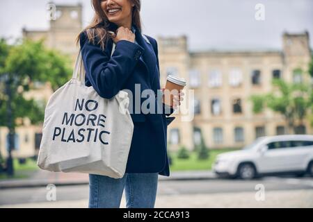 Attractive female student in front of educational establishment - Stock Photo