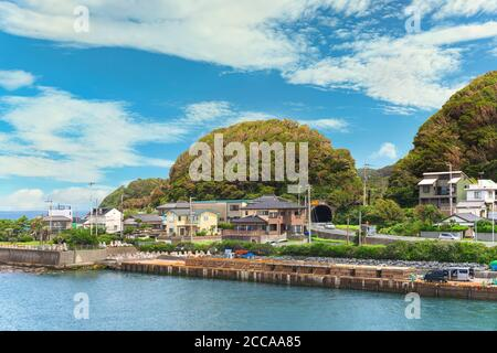 chiba, japan - july 18 2020: Coast of the Kanaya village in Futtsu city along the Uraga Channel with the National Route 127 passing through a tunnel i
