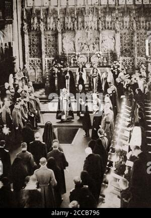 Following the death of King George V on 20th January, the coffin is lowered into his final resting place in St George's Chapel, Windsor Castle, on 28th January 1936. - Stock Photo