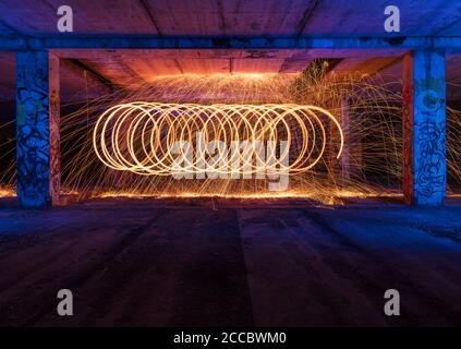 Steel wool fire photography shot on long exposure, making abstract shapes. - Stock Photo