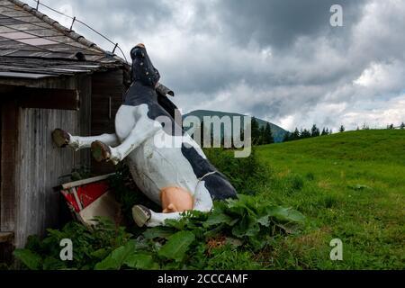 Funny alps pollution . Throwaway society . Lustige Umweltverschmutzung - Stock Photo