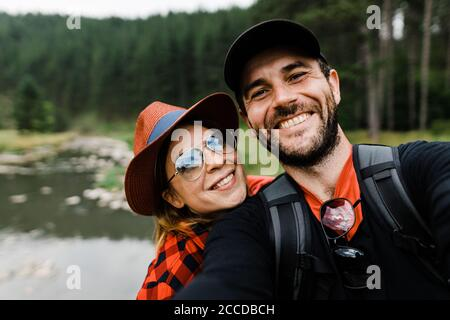 Selfie of a young couple in the mountains by the river Stock Photo