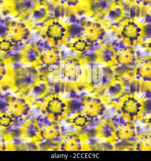 Tie dye shibori seamless pattern. Watercolor hand painted yellow and purple elements on white background. Watercolour abstract flowers texture. Print