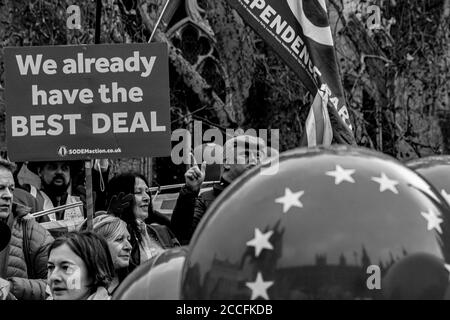 London,England. A mix of people campaigning for Brexit and against Brexit outside the UK parliament on the day a so-called 'meaningful vote' was to be taken by MPs on 10th December 2018.  The opportunity to vote was withdrawn at the last minute by Prime Minister Theresa May.bb Stock Photo