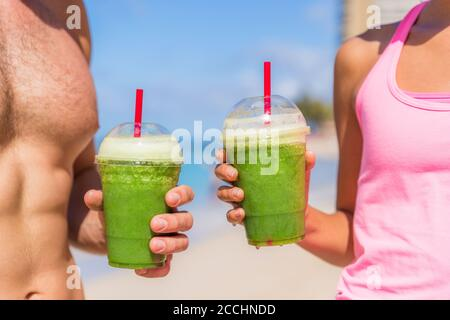 Green smoothie fit healthy people drinking juice Stock Photo