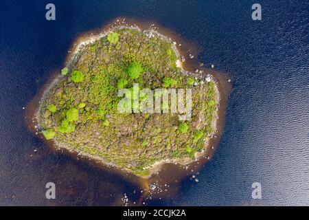 Aerial view of small island on  Loch Ba on Rannoch Moor in summer, Scotland, UK