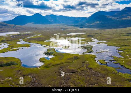 Aerial view of Lochan na Stainge on Rannoch Moor in summer, Grampian Mountains in distance, Scotland, UK Stock Photo