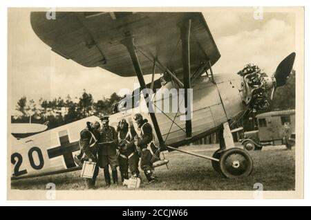 German historical photo postcard: the crew of a reconnaissance aircraft passes a pre-flight briefing at their aircraft, Germany, world war II - Stock Photo