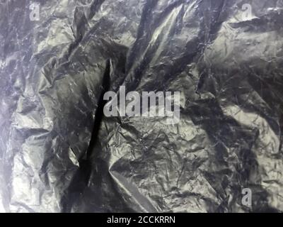 Cellophane plastic background texture packaging pattern shiny. Bag material industrial close up wrap