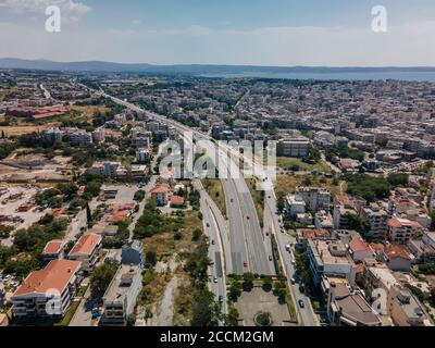 Thessaloniki, Greece aerial drone landscape view of city road traffic on multi lanes avenue.Day top panorama of European city with main highway & cars - Stock Photo