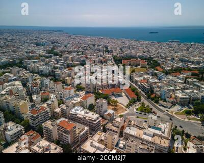 Thessaloniki, Greece aerial drone landscape view of Toumba borough buildings rooftops. Day top panorama of European city with residential .flats.
