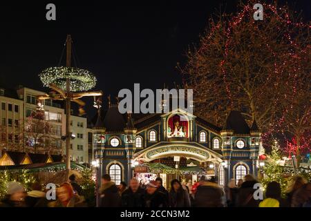 Night scenery, beautiful arched entrance of Weihnachtsmarkt, Christmas Market in Köln, at Alter Markt, famous marketplace nearby Cologne city hall.
