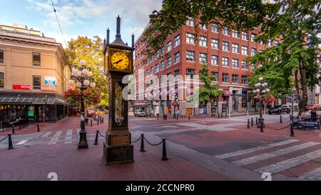 The famous Steam Clock on the corner of Water Street and Cambie Street in the historic Gastown part of Vancouver - Stock Photo