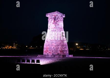 Cheomseongdae observatory by night used for weather prediction and astrology - observe stars and universe. Tower made of stone. Gyeongju, South Korea - Stock Photo