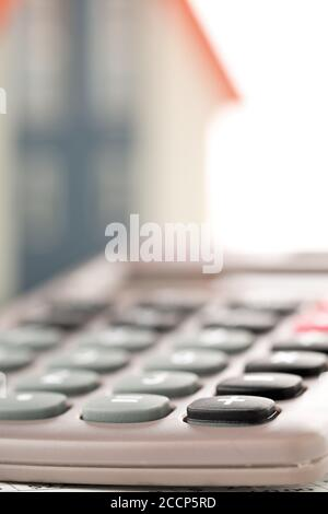 Pocket calculator house model, real estate investment or poroperty costs concept, selective focus Stock Photo