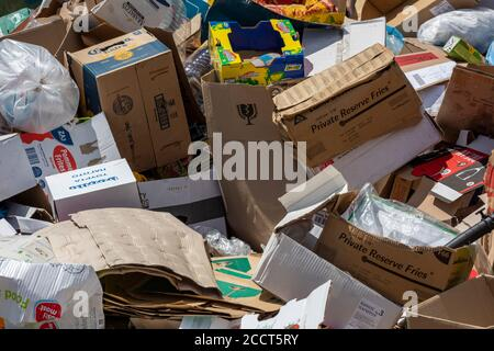 a pile of recycling and cardboard boxes waste rubbish ready for collection. - Stock Photo