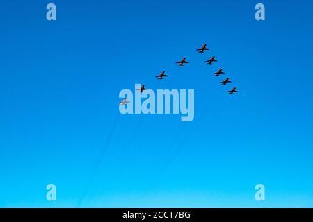 East Lothian, Scotland, United Kingdom, 24 August 2020. The RAF Aerobatics display team Red Arrows fly overhead against a clear blue sky - Stock Photo