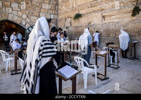 Group of orthodox Jews praying at Western Wall in Old City of Jerusalem - aka Wailing Wall or Kotel in Jerusalem, Israel. - Stock Photo