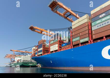 Containers being unloaded from container ship in the Prinses Amaliahaven, Maasvlakte 2 - Stock Photo