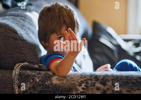 Montreal,Quebec,Canada,August 25, 2020.Shy young boy shunning at camera.Credit:Mario Beauregard/Alamy News Stock Photo