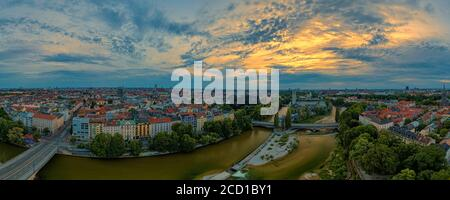 Munich city center with the Frauenkirche and the Isar river from above at an aerly sunrise the 23th of may 2020, bavaria, germany - Stock Photo
