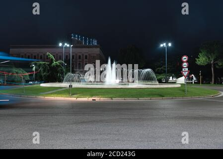 Timelapse view of the traffic on the square around the fountain. Urban roundabout in the Italian city of Brescia.Time Lapse.