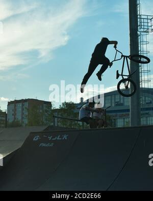 BMX stunt vertical. A professional cyclist Extreme cycling concept. Dert jump. BMX vertical barspin jump. BMX Freestyle Vert Stunt. Halframp. Set Of Skatepark Element