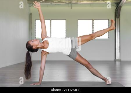 sporty yogi girl doing fitness exercises backbend asana