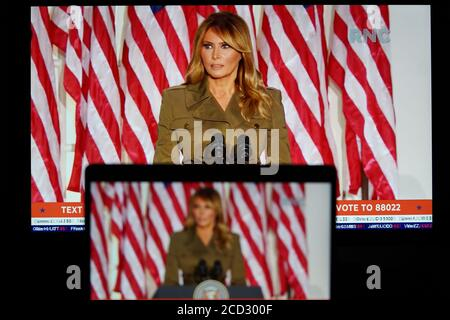 Washington, USA. 25th Aug, 2020. Photo taken in Arlington, Virginia, the United States, Aug. 25, 2020 shows screens displaying U.S. first lady Melania Trump speaking during the 2020 Republican National Convention from Washington, DC Credit: Liu Jie/Xinhua/Alamy Live News - Stock Photo