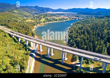 Viaduct Bajer above idyllic lake and town of Fuzine aerial view, Scenic highway A6 in Gorski Kotar region of Croatia, - Stock Photo