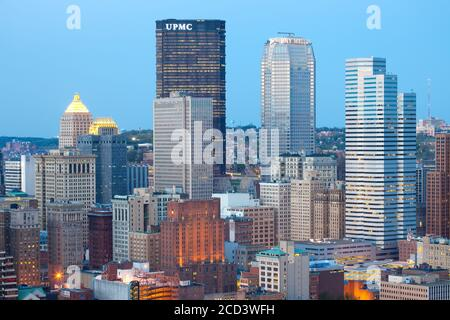 Pittsburgh, Pennsylvania, United States - Panoramic view of skyscrapers in central Business district of Pittsburgh at dusk. - Stock Photo