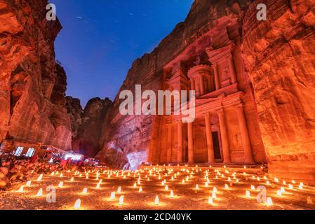Petra, Jordan. Al Khazneh in the ancient city of Petra night known as The Treasury famous travel destination in Middle-East. - Stock Photo