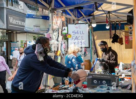 Staines-upon-Thames, Surrey, UK. 26th August, 2020. A busy day for market traders selling face masks on market day in Staines. Credit: Maureen McLean/Alamy Live News - Stock Photo