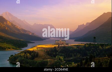 Prince of Wales Hotel on lakeshore at sunset, Waterton Lakes National Park, Alberta, Canada
