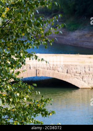 Old stone bridge near Mrzla vodica Lokve in Croatia Europe aka hightide high-tide - Stock Photo