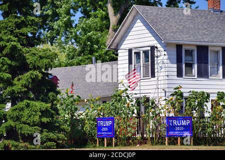 Flagg Center, Illinois, USA. A homeowner displays their political priority and support for Donald Trump with signs in the front and side yard. - Stock Photo