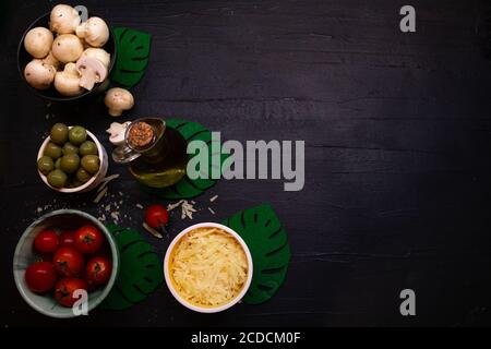 Ingredients for cooking on ablack background. Top view, copy space - Stock Photo