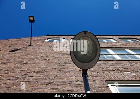facade lighting on old brick house with blue sky