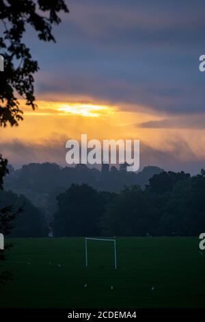 Northampton, UK, Weather. 28th August 2020. Dawn sky breaking through the clouds over Abington Park  this morning with another wet day forecast for Northampton. Credit: Keith J Smith./Alamy Live News - Stock Photo