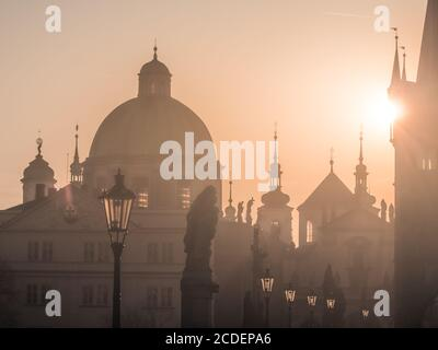 Sunrise over Charles Bridge and Old Town towers, Prague, Czech Republic. - Stock Photo