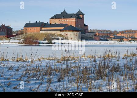 View of the ancient fortress of the Hameenlinna city from the shores of Vanajavesi lake on a March day. Finland - Stock Photo